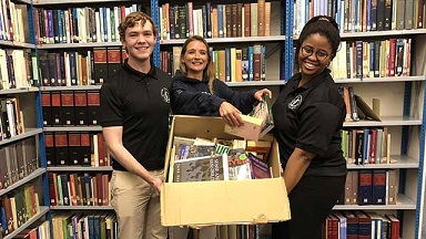 Rhodes Law Society bolsters literacy with book drive