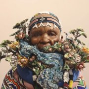 Mandela student makes MaskBook Project mask for Paris Agreement Climate Summit